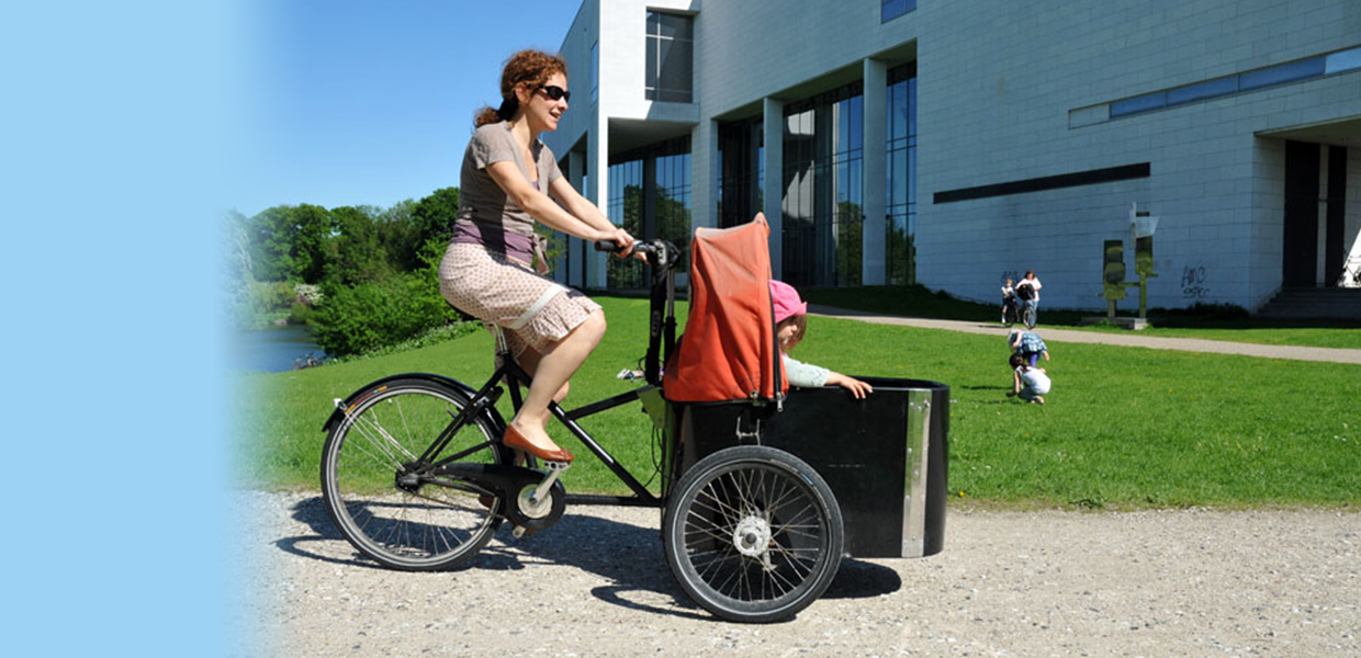 mother with kid in the cargo bike